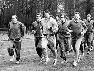 Joe Lancaster, left, training the Manchester City squad with, centre, Malcolm Allison and, right, former mile world record-holder Derek Ibbotson