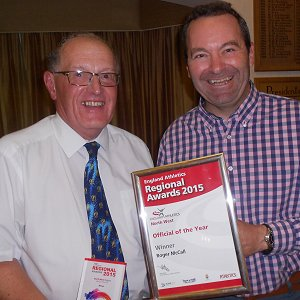 Roger (left) receives his award as official of the year 2015 from EA