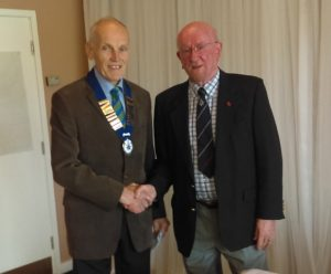 Mr kevin Carr receives his chain of office from retiring President Mr Roy Swainbank.